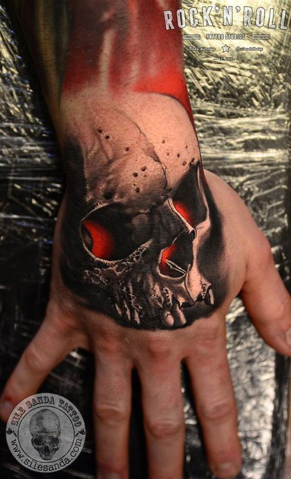 Red Glowing Skull Hand Tattoo