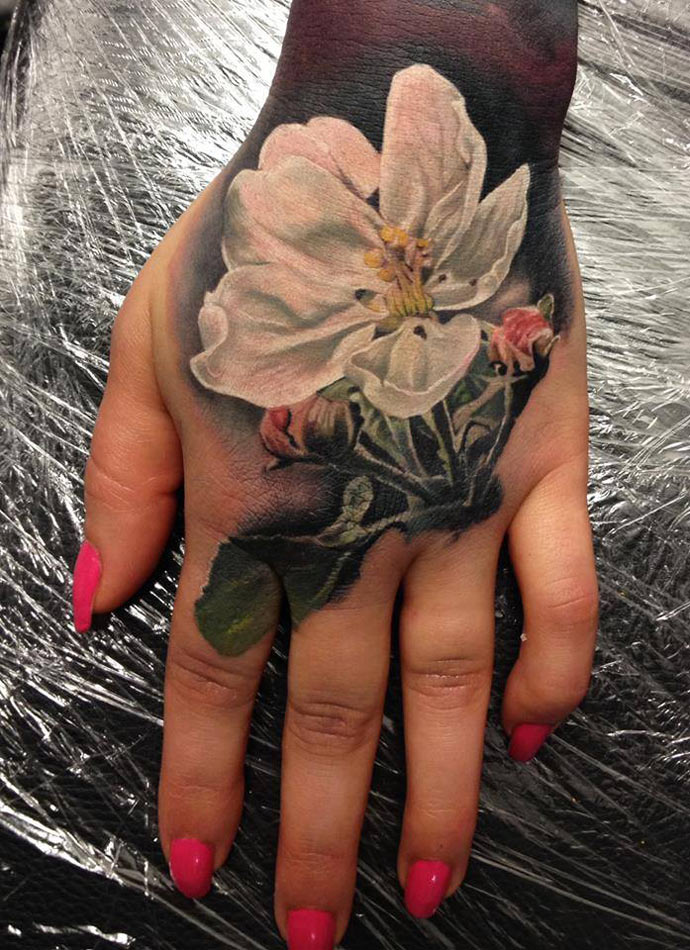 White Flower Hand Tattoo
