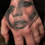 Girls Face Hand Tattoo