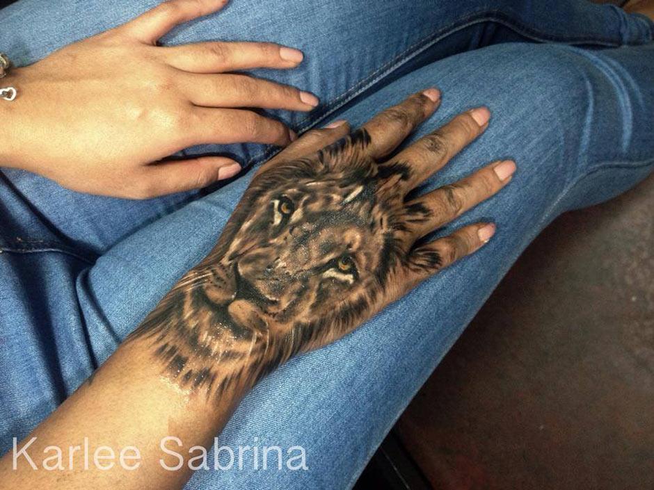 Stunning lion hand tattoo best tattoo design ideas for Finger lion tattoo