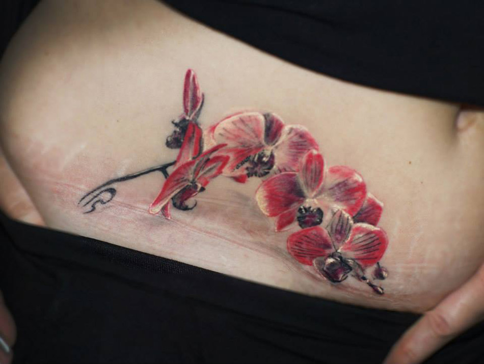 Orchid Belly Tattoo
