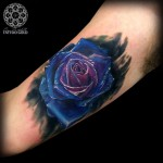 Blue Rose Inner Bicep Tattoo