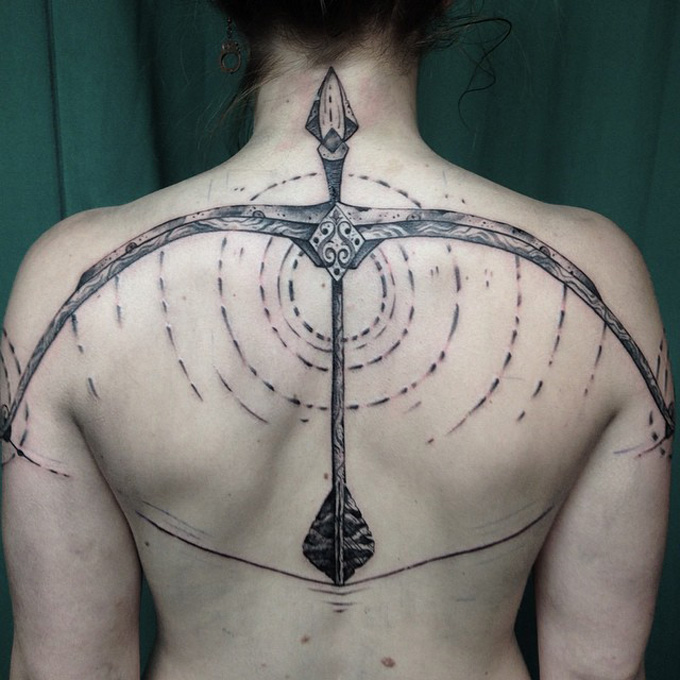 Bow and Arrow Back Tattoo