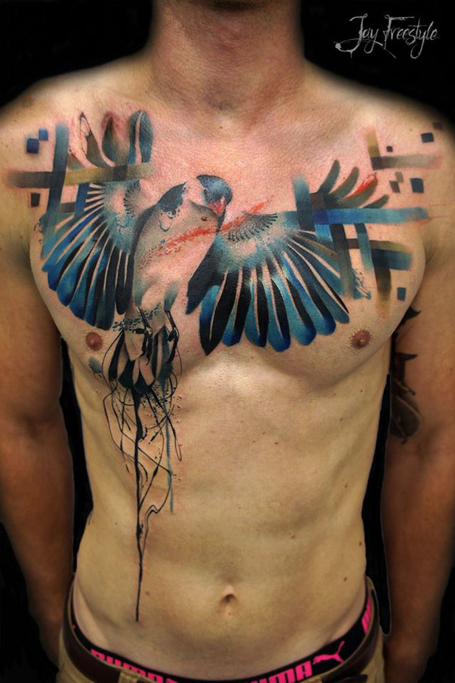 Hovering Bird Chest Tattoo