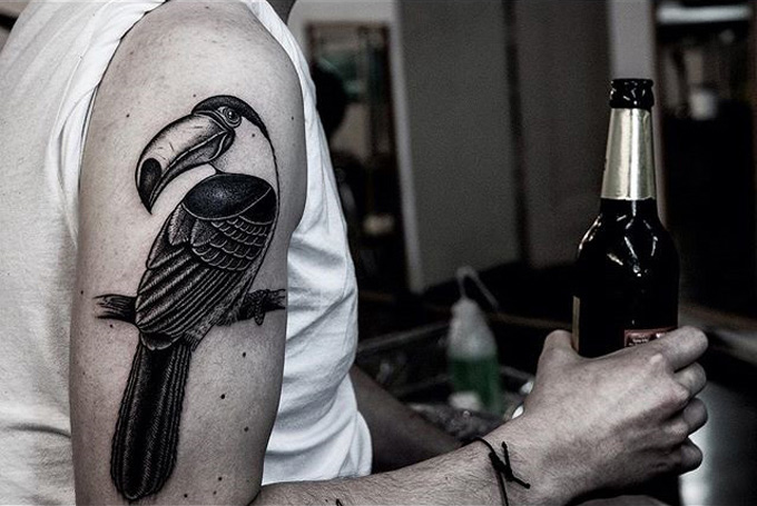 Toucan black ink tattoo