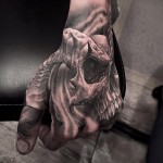 Skull with horns hand tattoo