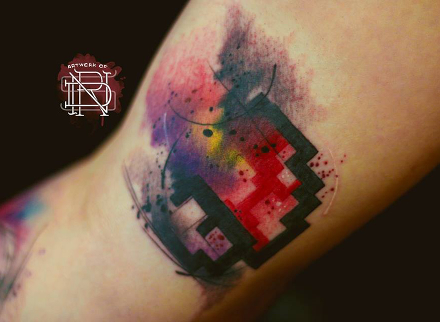 Watercolor mario mushroom on bicep best tattoo design ideas for Mario mushroom tattoo