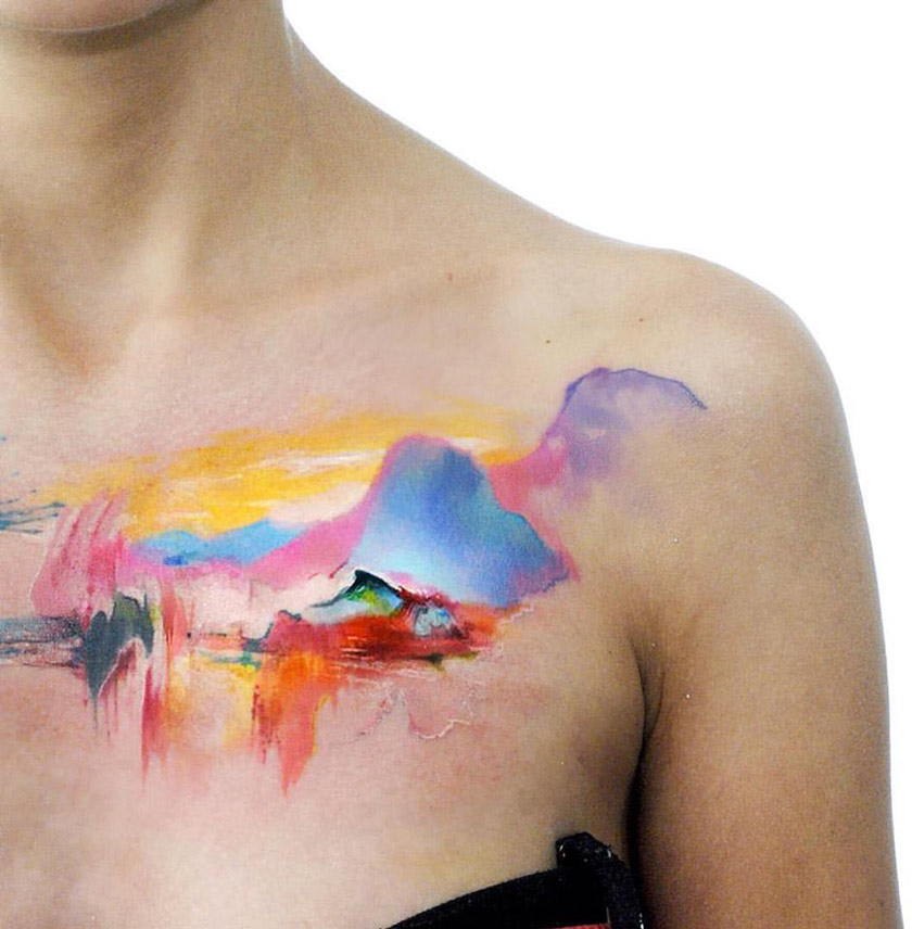 Watercolor Mountains On Girls Chest | Best tattoo design ideas
