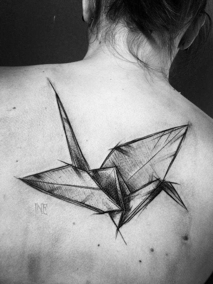 Origami bird tattoo