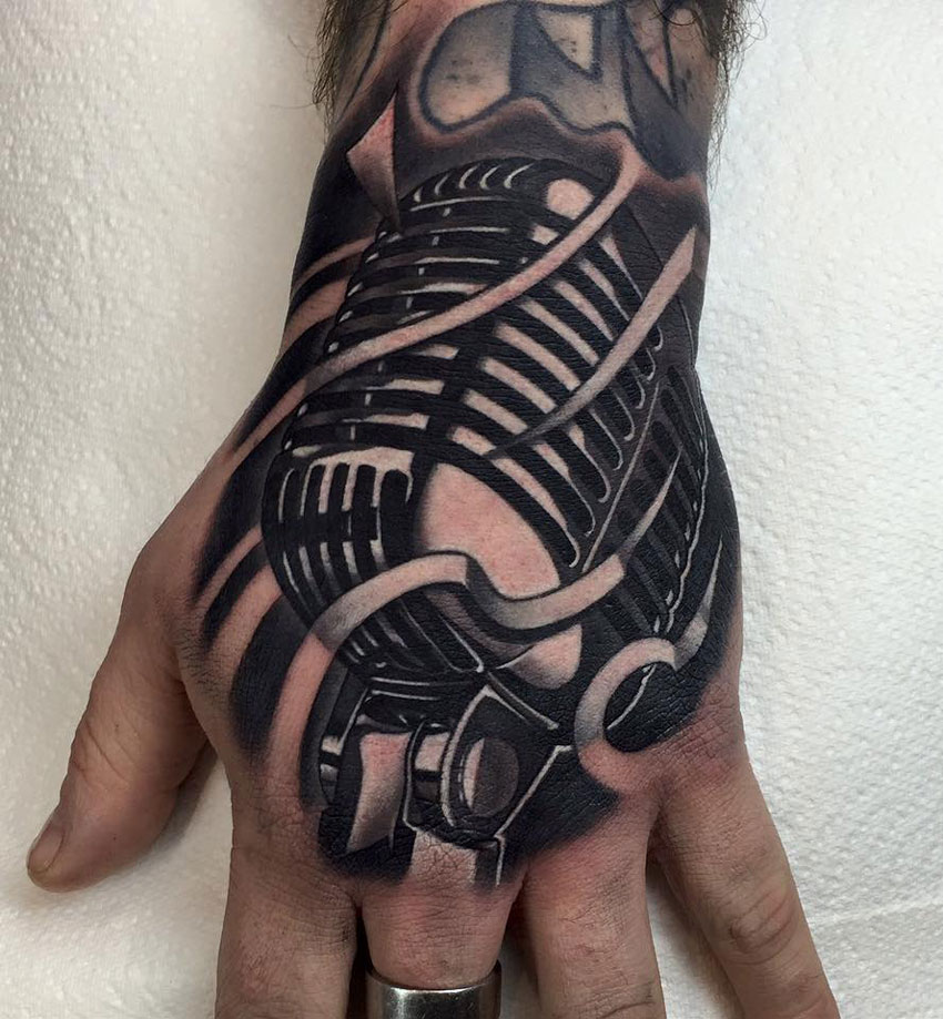 Retro Mic hand tattoo
