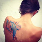 Dolphin Back Tattoo