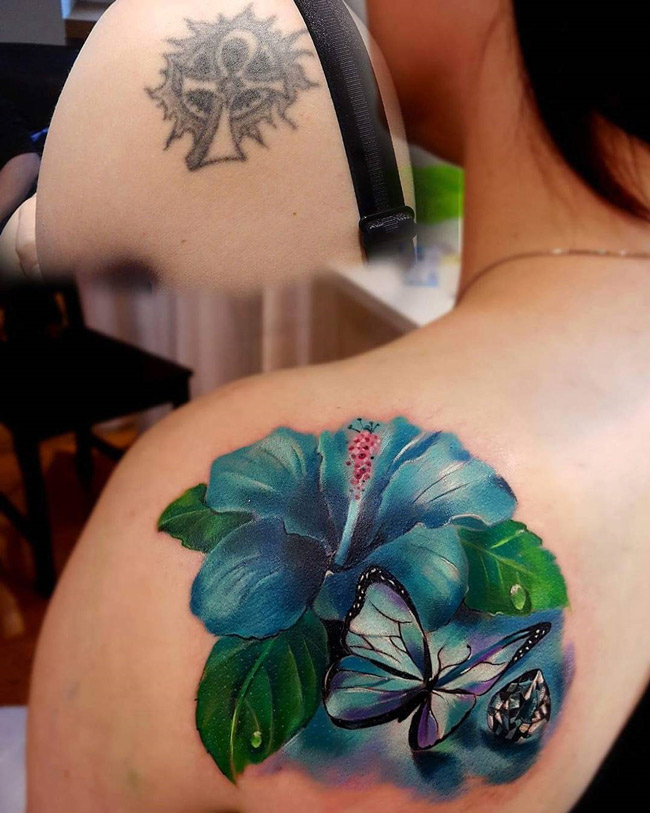 Hibiscus & butterfly shoulder tattoo