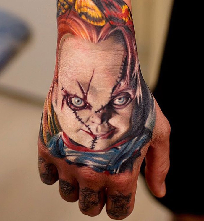 chucky tattoo on guy 39 s hand best tattoo ideas designs