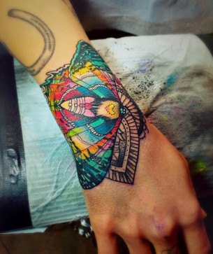 Colorful Moth Wrist Tattoo