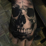 Creepy Skull Hand Tattoo
