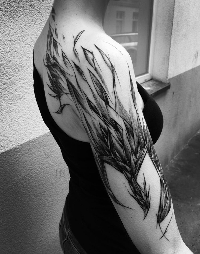 Pheonix arm tattoo