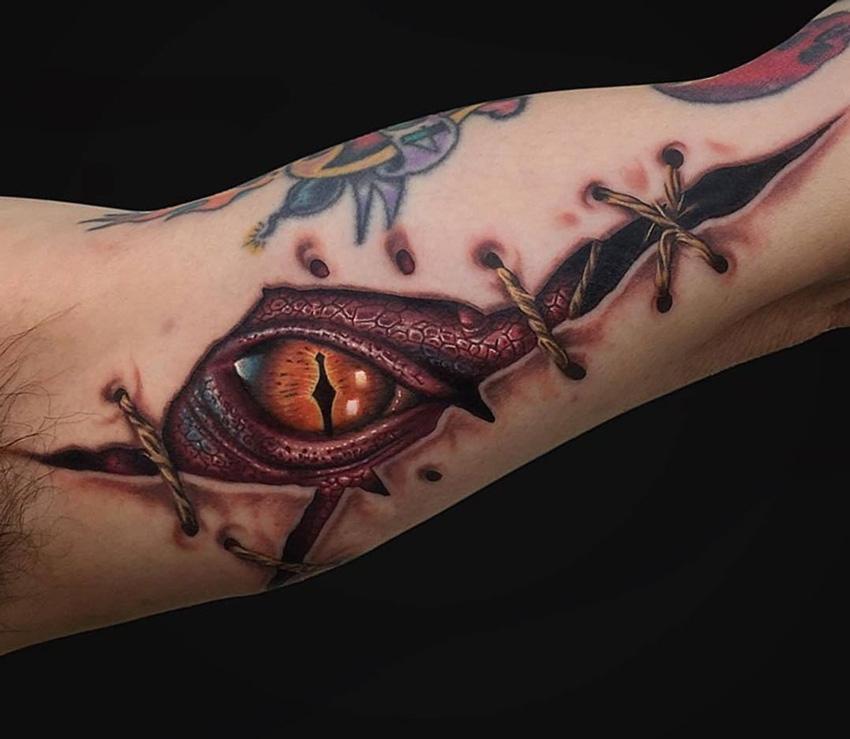ripped skin smaug dragon best tattoo design ideas. Black Bedroom Furniture Sets. Home Design Ideas