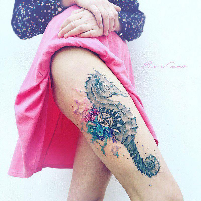 Seahorse thigh tattoo