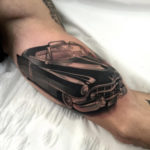 Retro Cadillac guy's arm tattoo