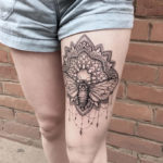 Moth mandala thigh tattoo