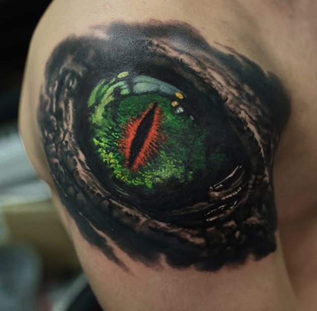 Dragon eye shoulder tattoo