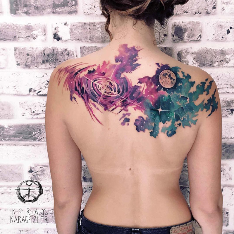 Space clouds back tattoo