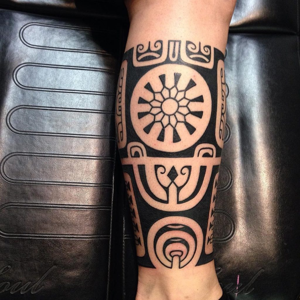Maori Lower Back Tattoo: Black Ink Tribal Leg Tattoo