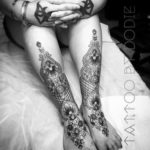 Ornamental matching leg tattoos