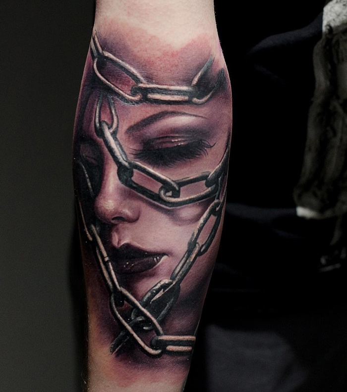 Face in chains best tattoo design ideas for Chain tattoo on arm