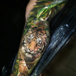 Tiger in the jungle realism tattoo