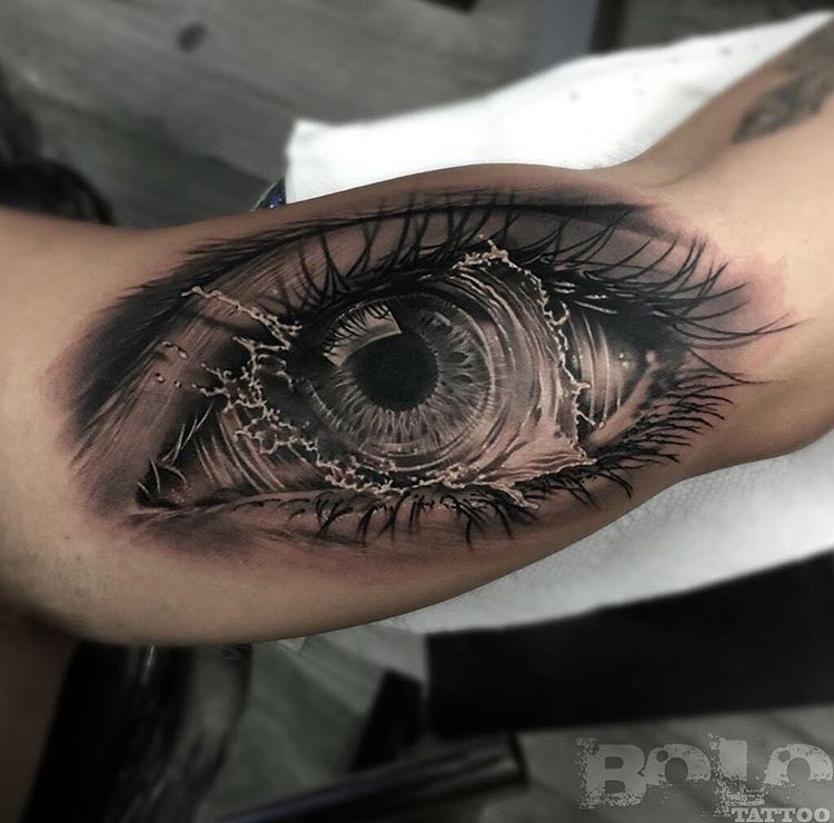 Realistic eye with tear in a whirlpool best tattoo for Eye tattoo art