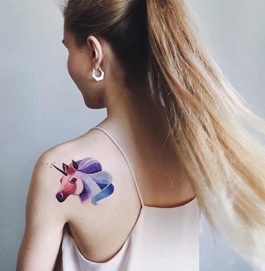 Unicorn girls shoulder tattoo