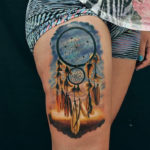 Dreamcatcher on girls thigh