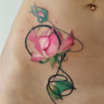 Pink rose girls stomach tattoo