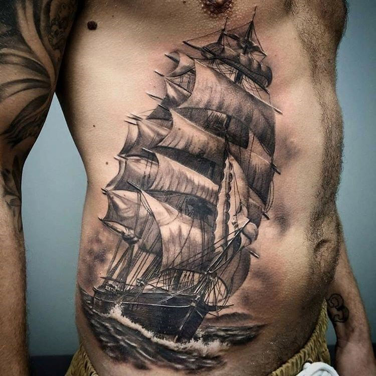 Sailing ship side tattoo
