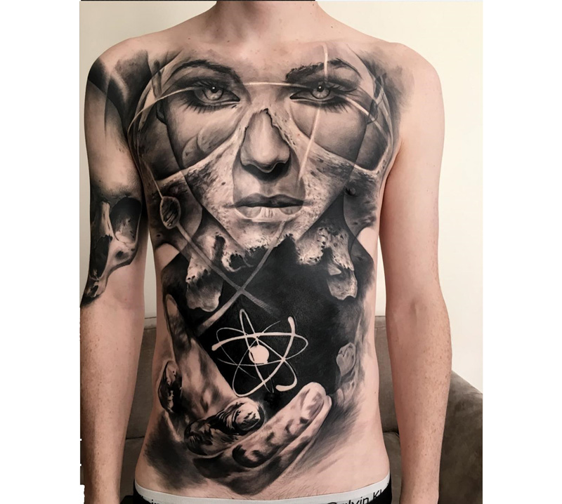 76df5f1249c9e Intriguing mens front tattoo, a skull merged with a portrait of a girl, and  a hand held out with an atom floating above. Created by Jak Connolly, ...