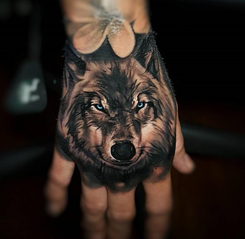 Evil wolf tattoo on girls hand best tattoo design ideas for Animal hand tattoos
