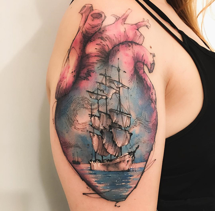 Heart & sailing ship arm tattoo