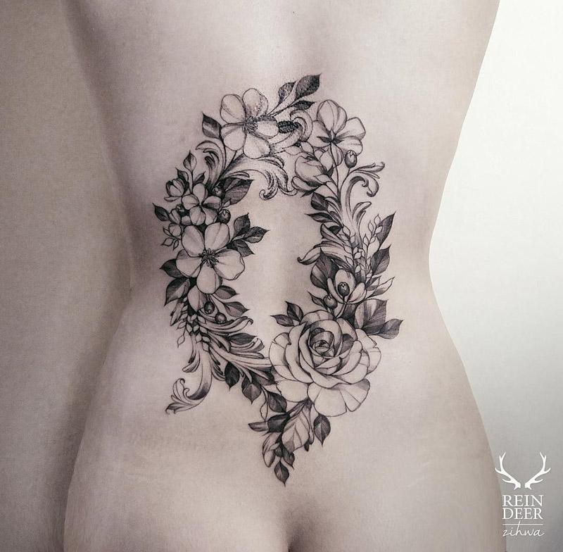 ec6ede393 Floral Wreath on Girls Lower Back | Best tattoo design ideas