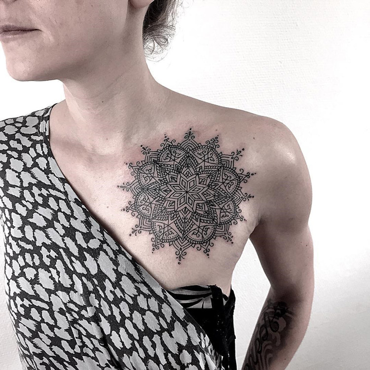 Black ink mandala on girls chest