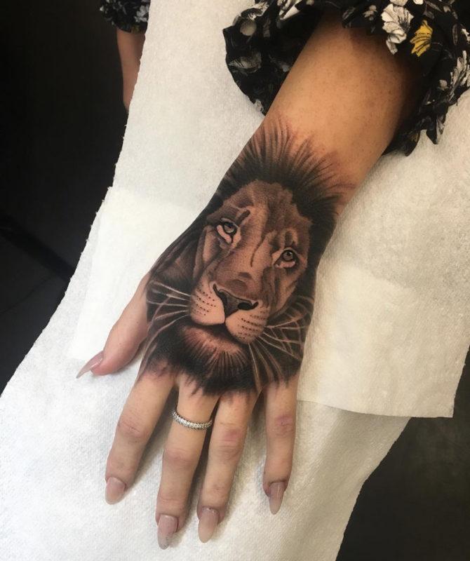 Lion Hand Tattoo