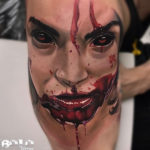 Evil face blood tattoo
