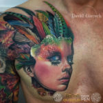 Feathers abstract portrait tattoo