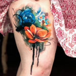 Colorful flowers girls thigh tattoo