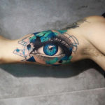 Abstract eye arm tattoo