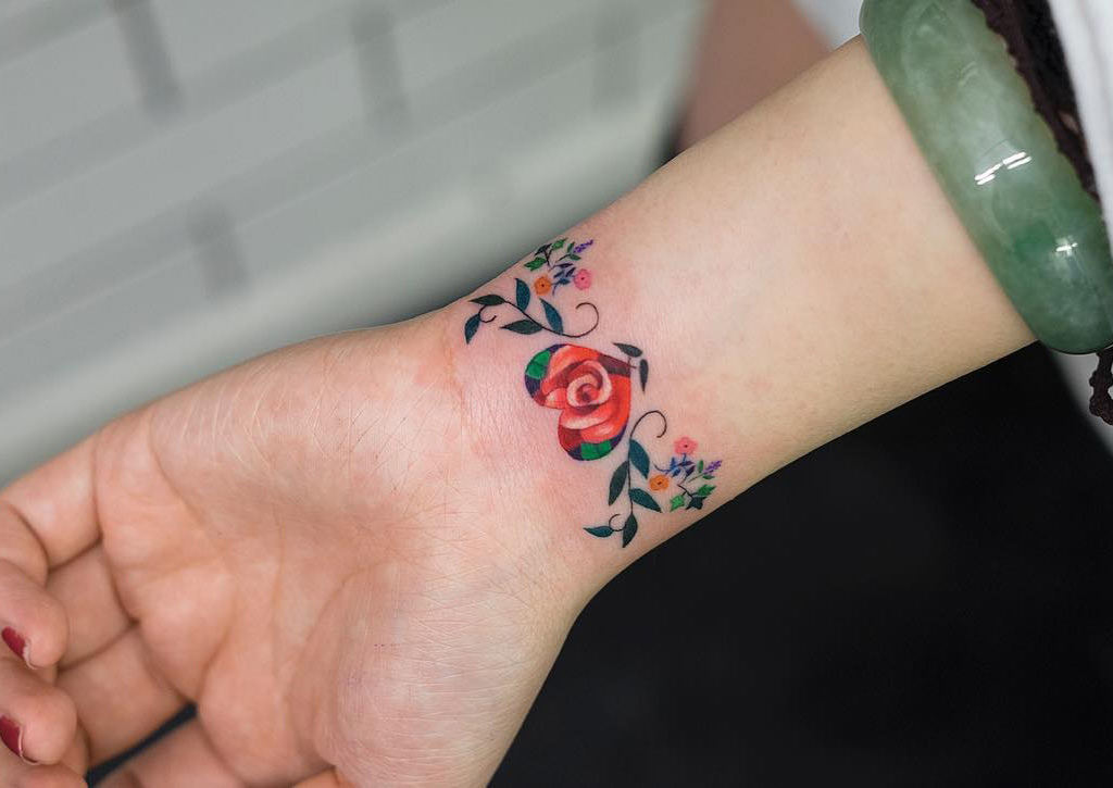 Wrist Cuff Tattoo Designs: Floral Heart Bracelet On Girl's Wrist