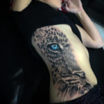 Blue-Eyed Leopard Side Tattoo