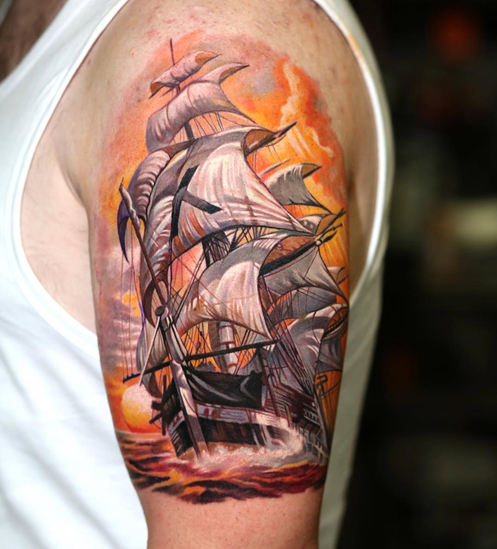 Sailing ship with orange sky mens upper arm piece best for Realistic sun tattoo