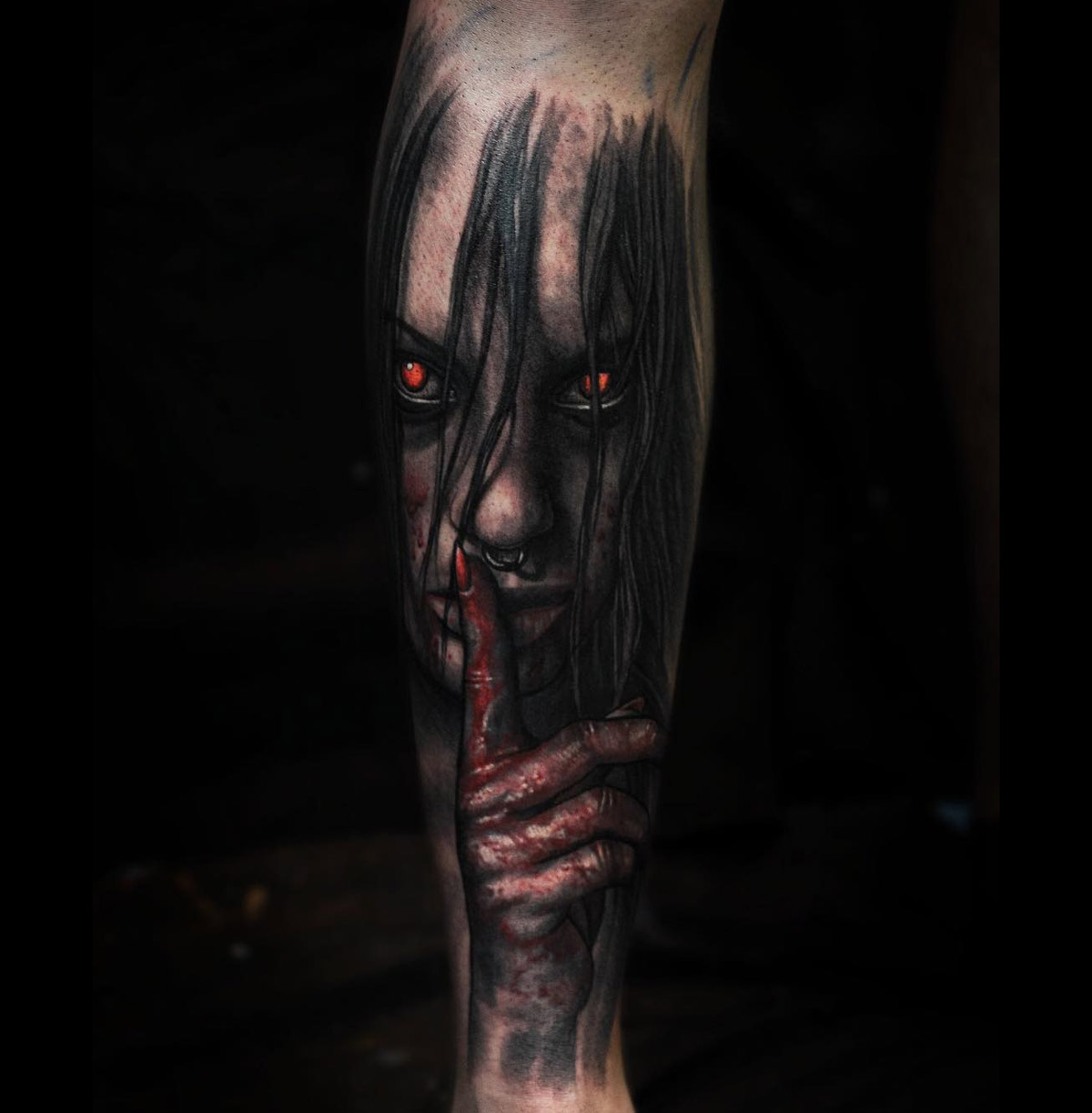 Devil with glowing eyes tattoo