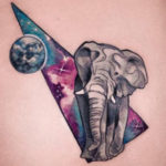 Space elephant, girl's hip tattoo